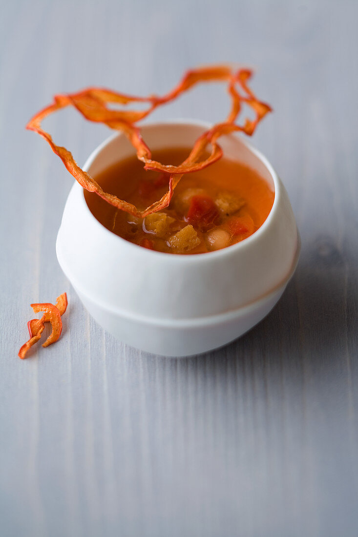 Melon and pepper gazpacho with cinnamon blossom croutons and chilli