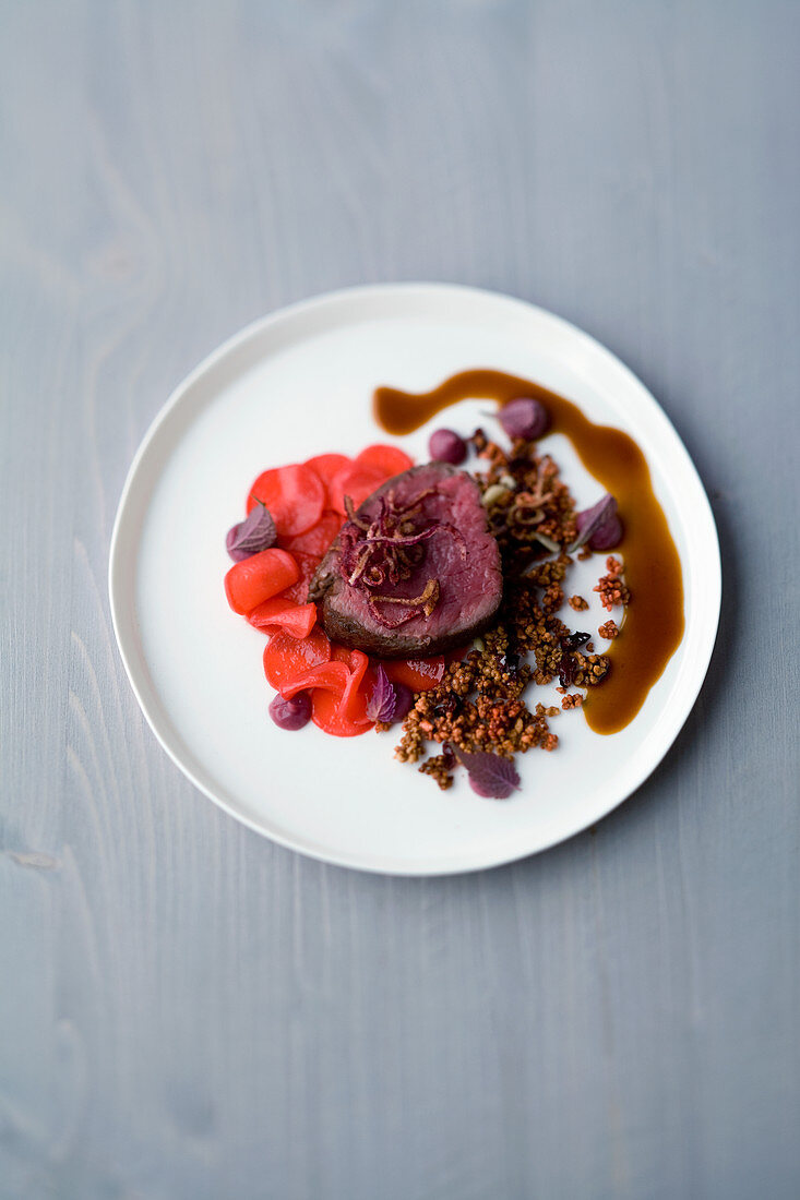 Cured beef fillet with blueberries and red cabbage