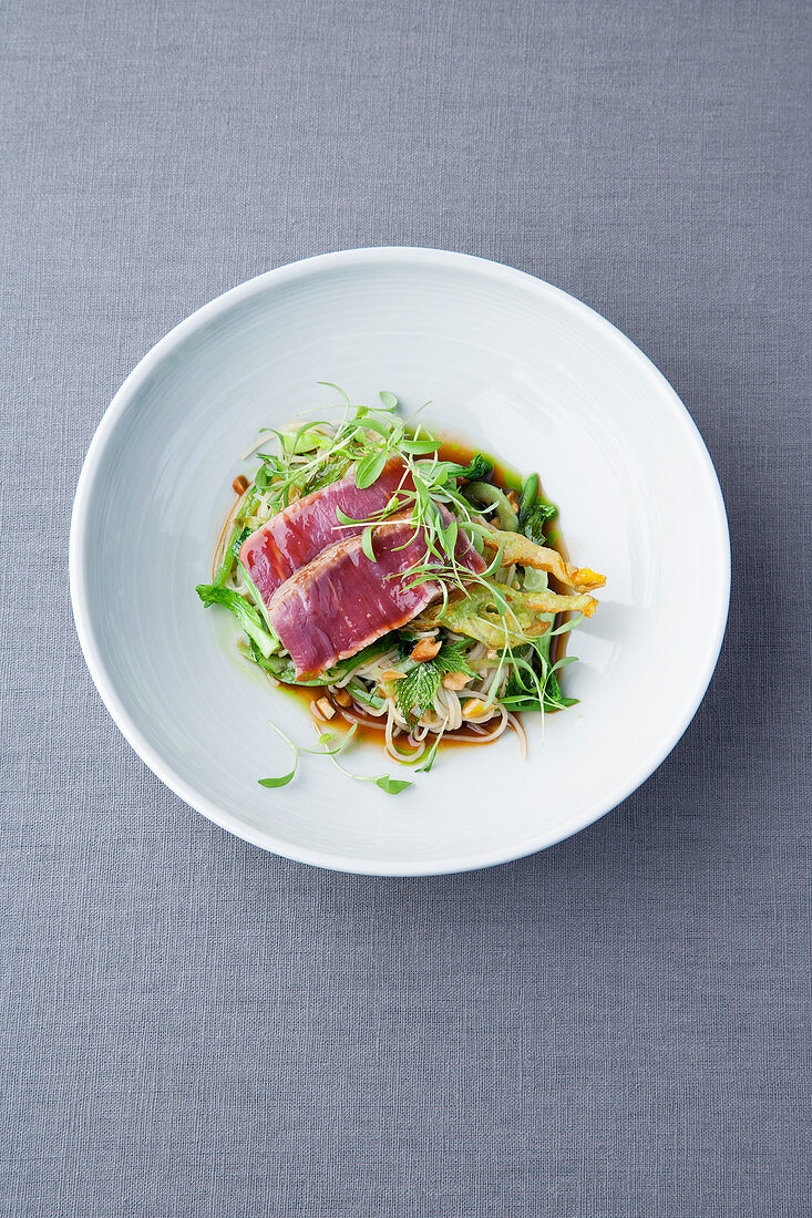 Beef fillet tataki with ramen noodles and pandan leaf stock