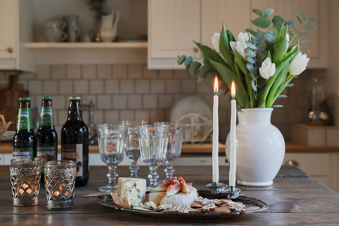 Plate of cheese and biscuits on table in country-house kitchen