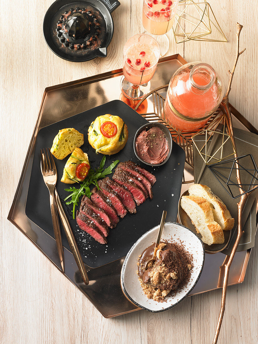 Savoury Christmas gourmet breakfast with hip steak and spicy muffins