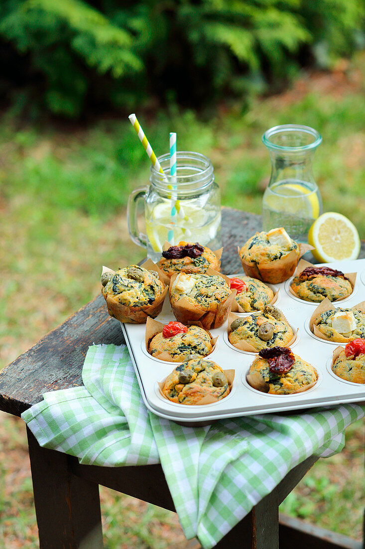 Savoury muffins and lemonade in a garden table