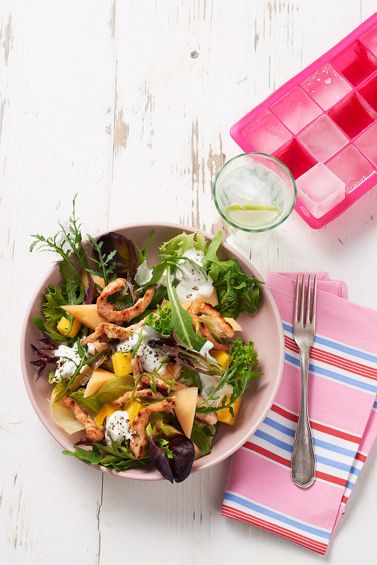 Summer salad with melon and chicken