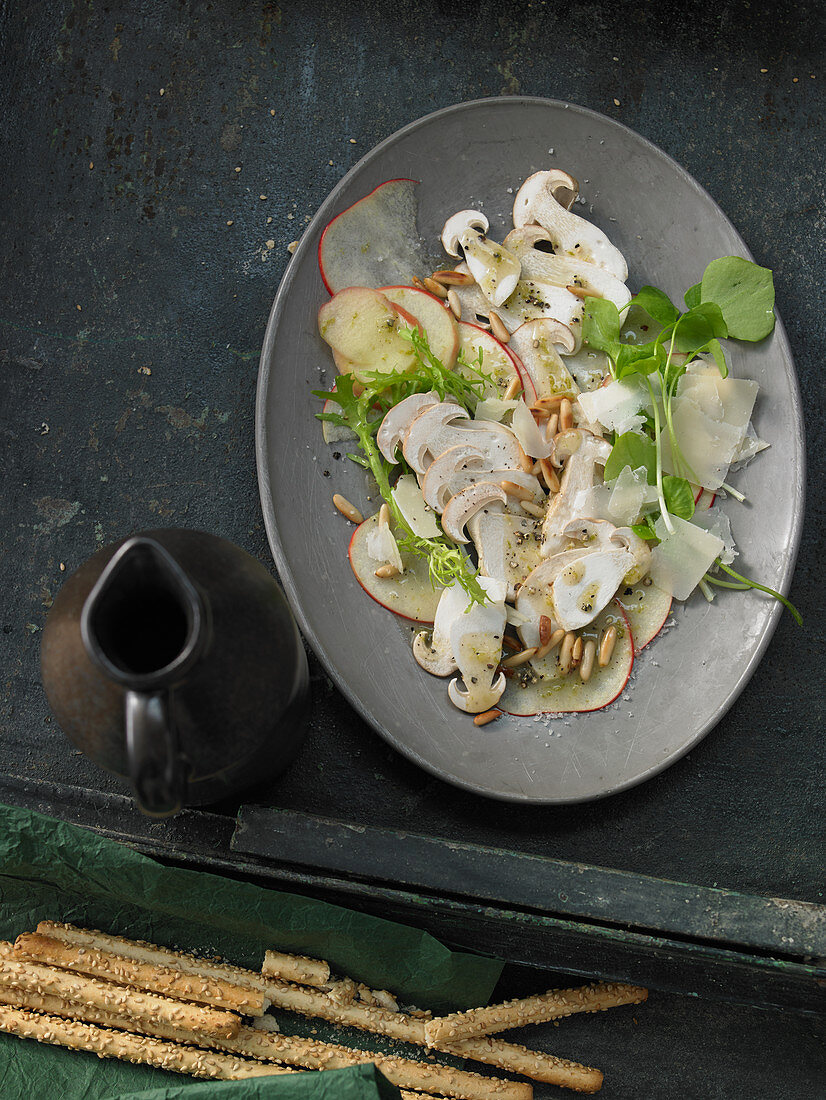Mushroom and apple carpaccio with lime oil, pine nuts, pecorino and, purslane with breadsticks