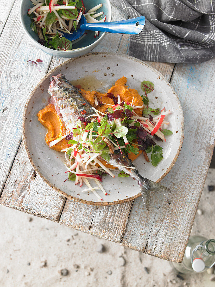 Grilled mackerel on mashed lentils with an apple and herb salad