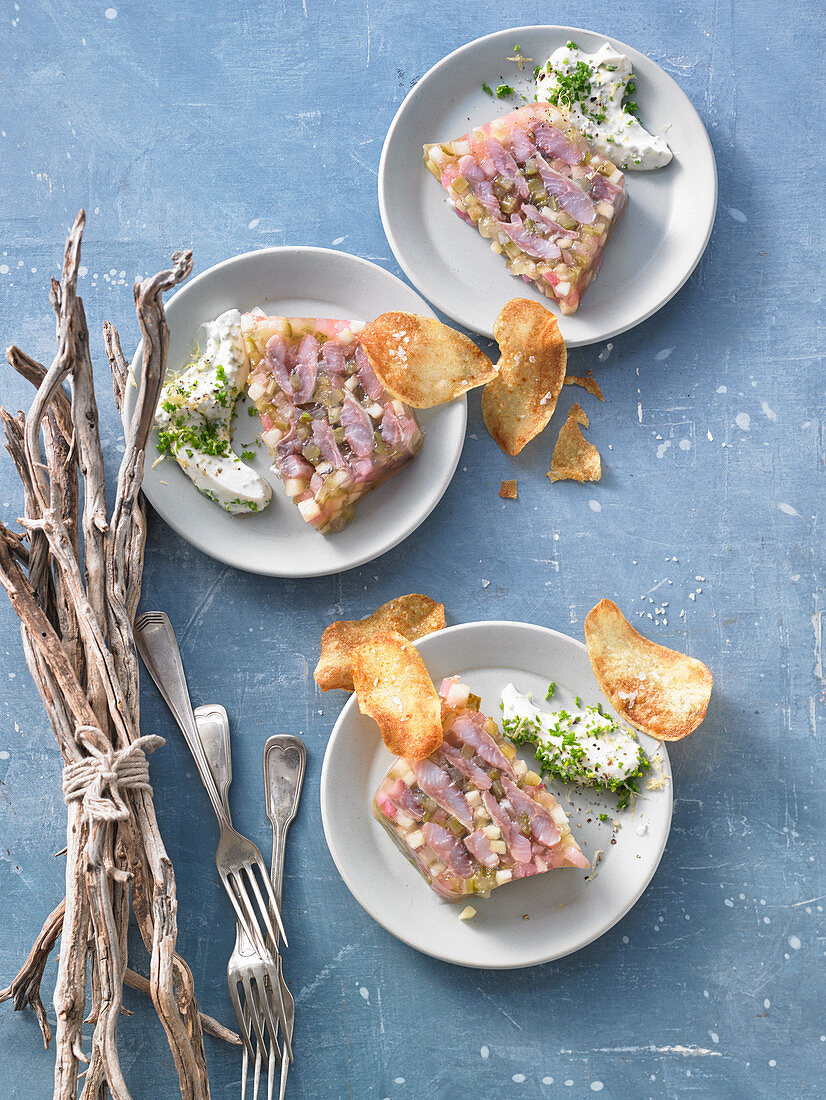 Herring in spicy apple jelly with chive cream