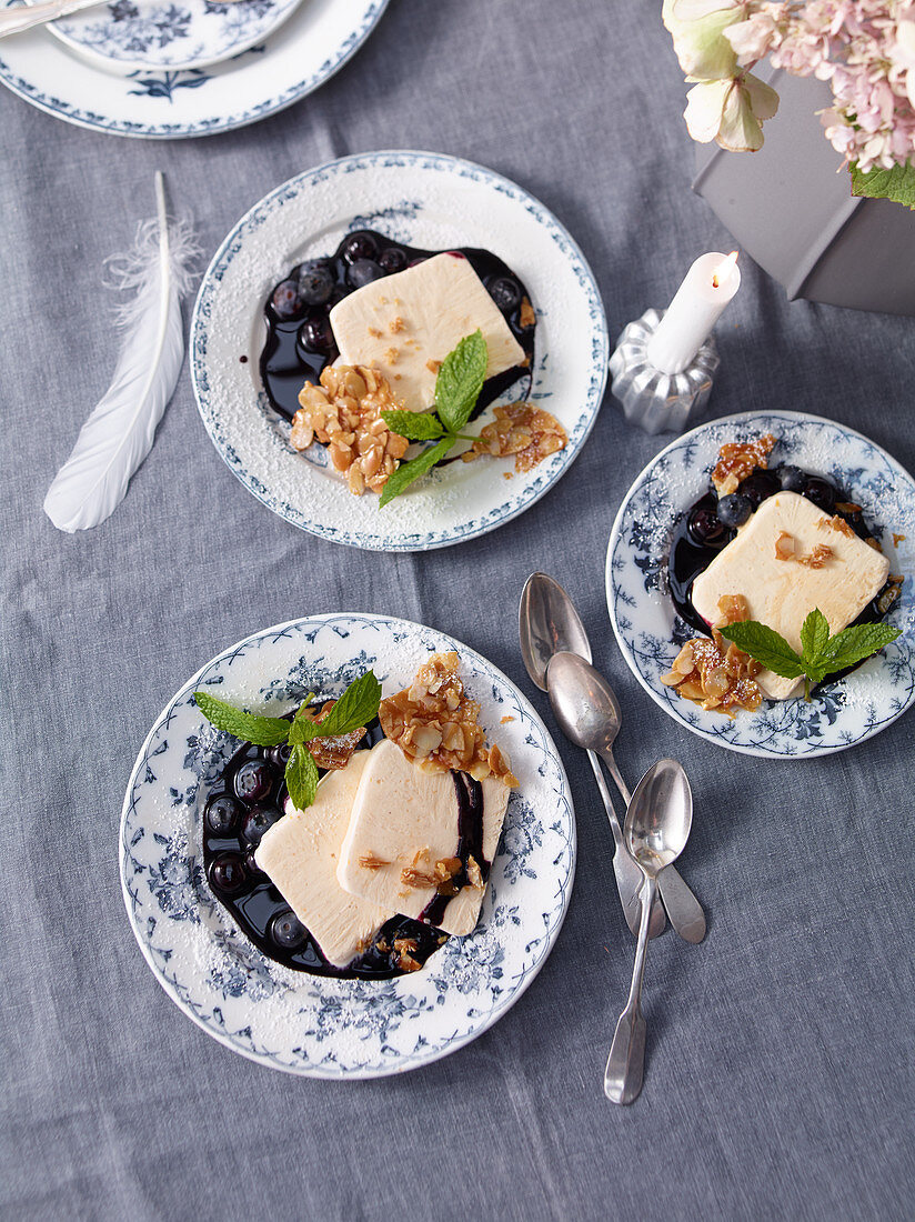 Sour cream parfait with blueberry sauce and almond brittle