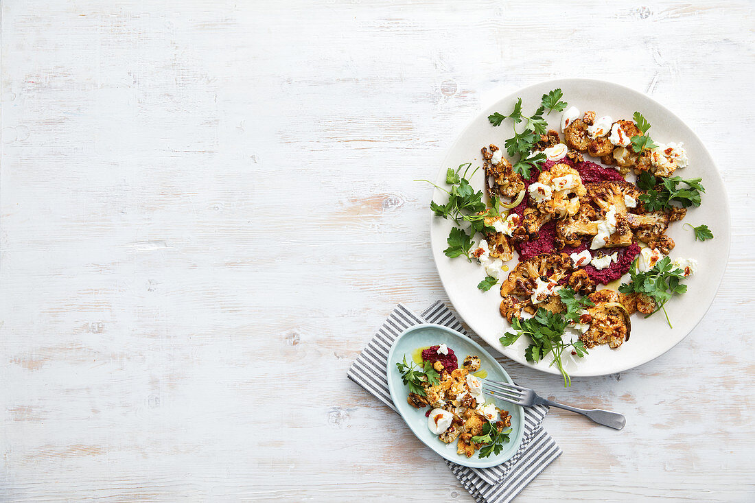 Harissa-roasted cauliflower with beetroot yoghurt and candied walnuts
