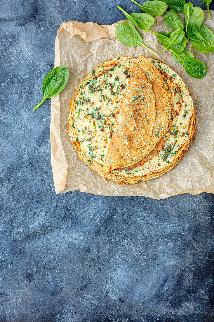 Crepes with fried spinach