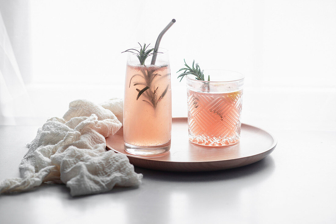 Pink grapefruit drink with rosemary