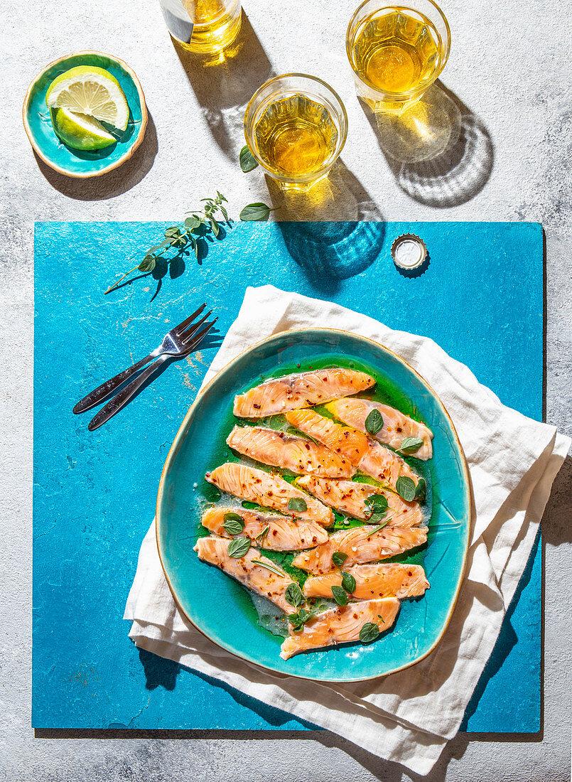 Latin American and Italian dish Crudo de Salmon. Raw Salmon marinated in lemon juice and spices. Top view.