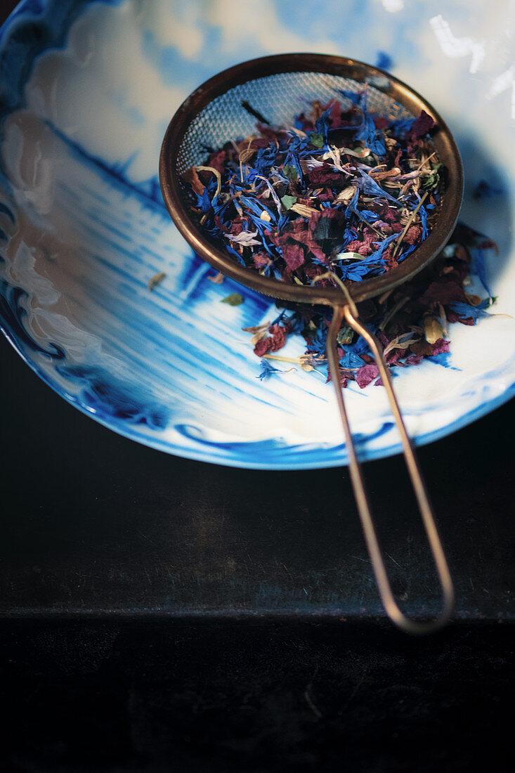 Tea leaves in a tea strainer