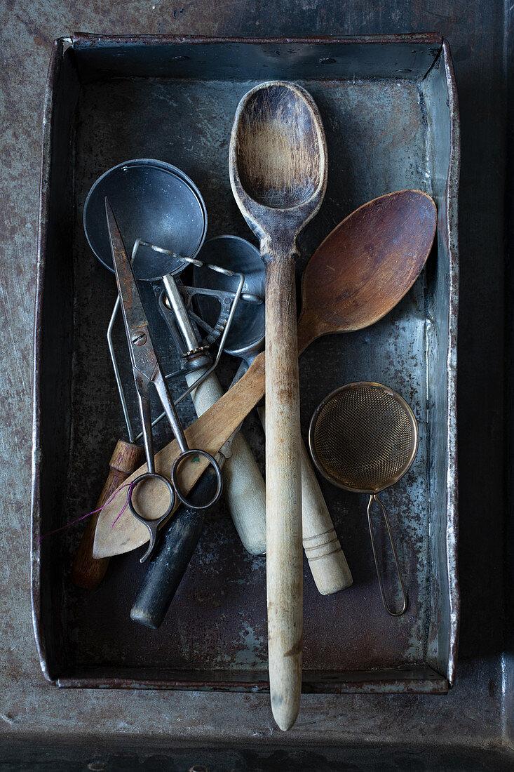 Various vintage kitchen utensils