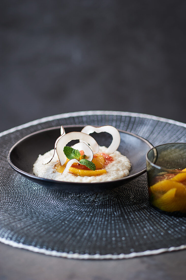 Coconut rice pudding with citrus fruit salad