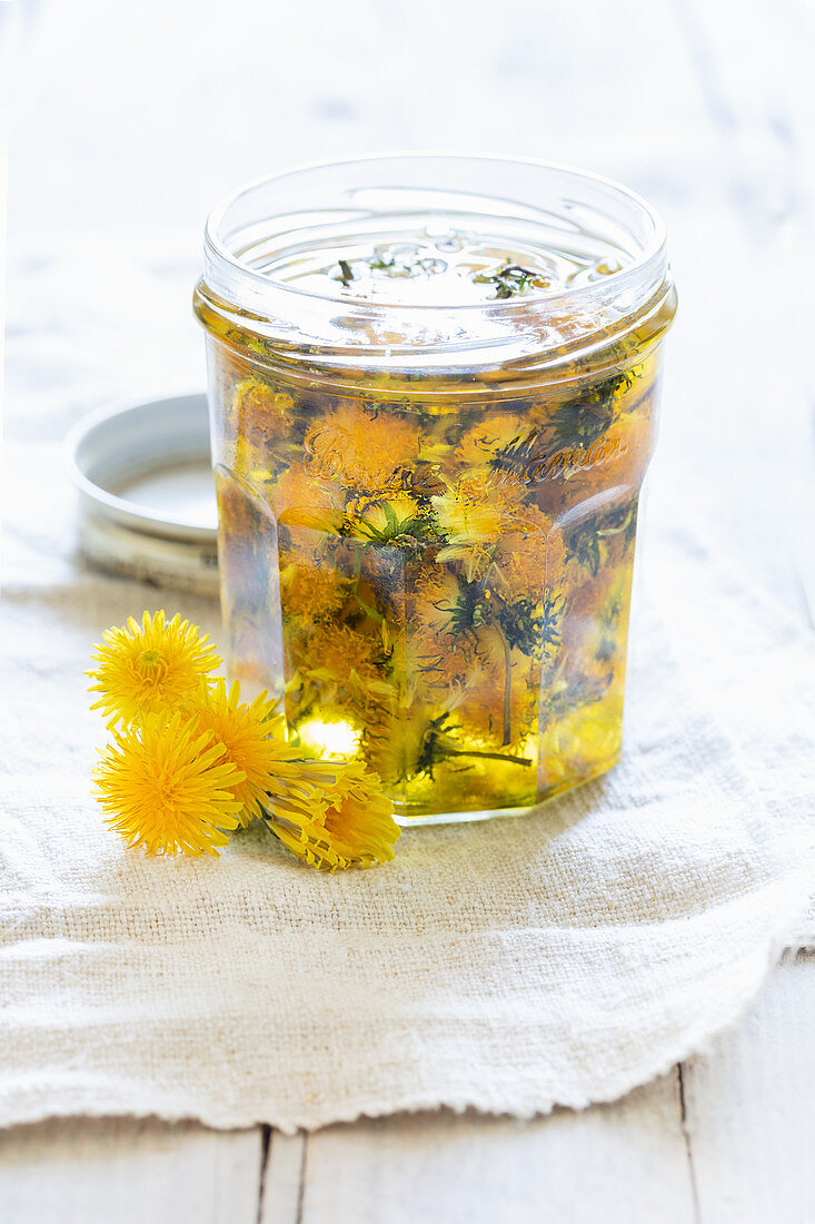 Oil extracted from dandelion flowers and sunflower oil