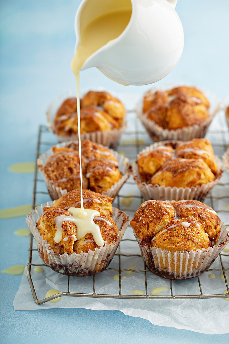 Cinnamon roll pull apart muffins with cream cheese glaze