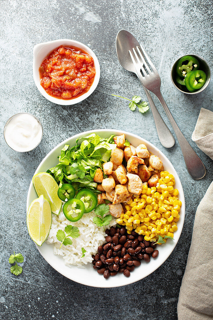 Mexican style lunch bowl with chicken, rice, black beans and corn