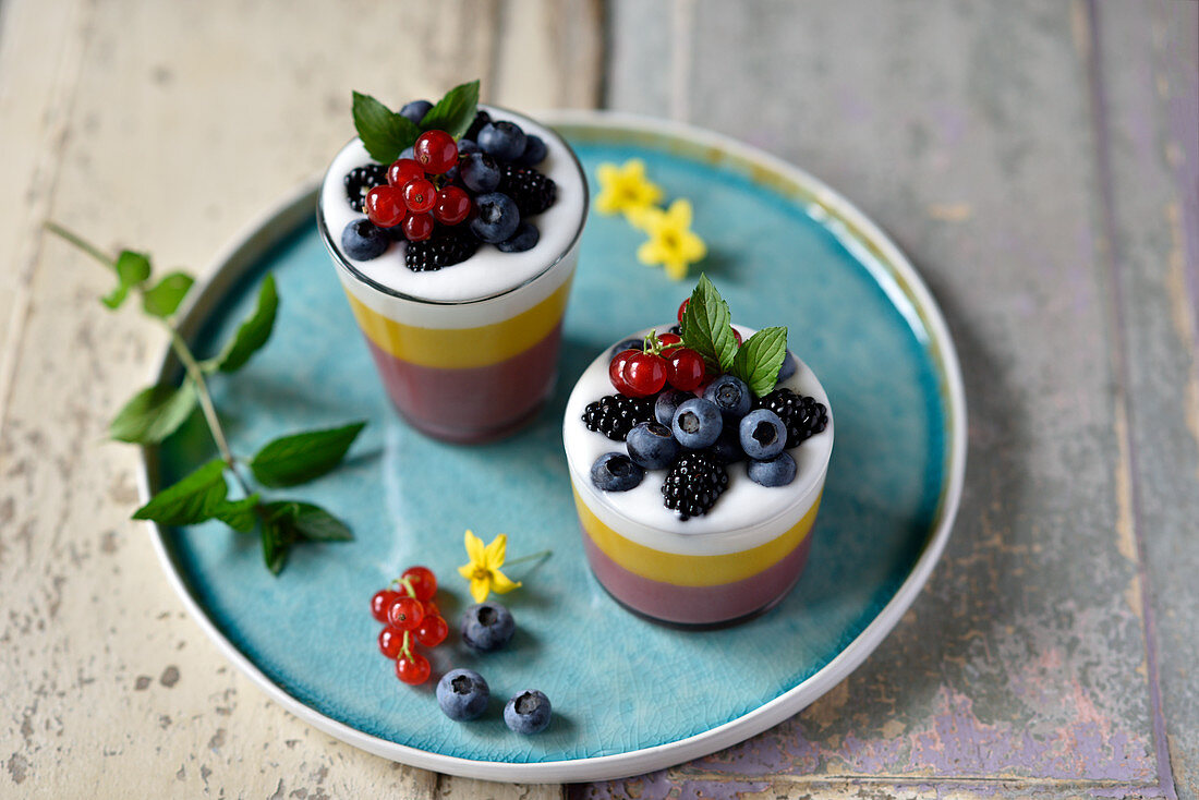 Vegan cherry-mango-and-coconut dessert in glasses