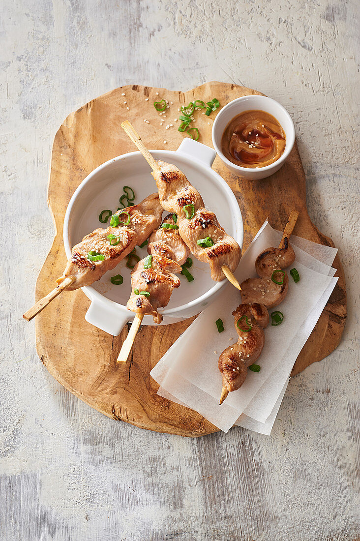 Chicken satay on a stick with peanut sauce