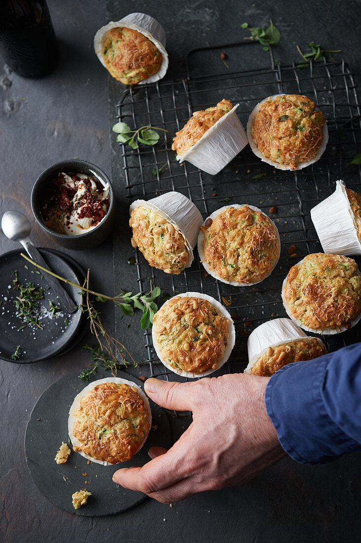 Courgette and pine nut muffins with a tomato dip