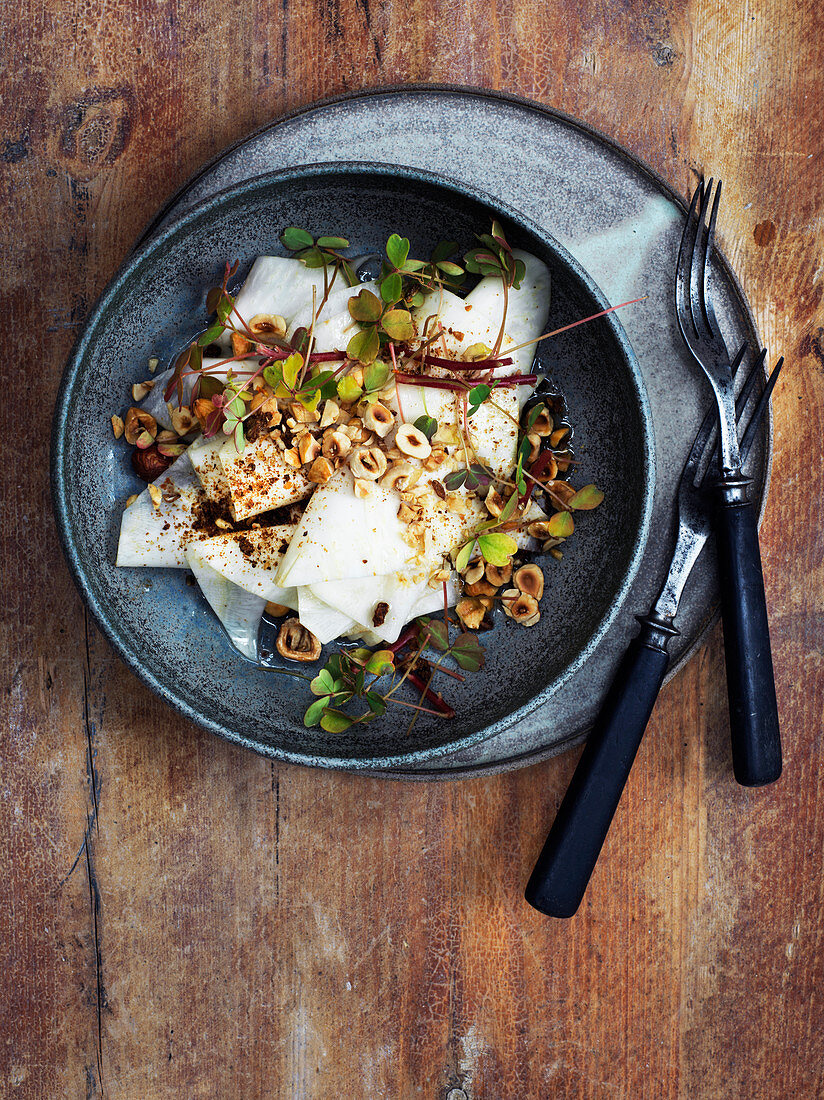 Pickled celeriac with hazelnuts and cress