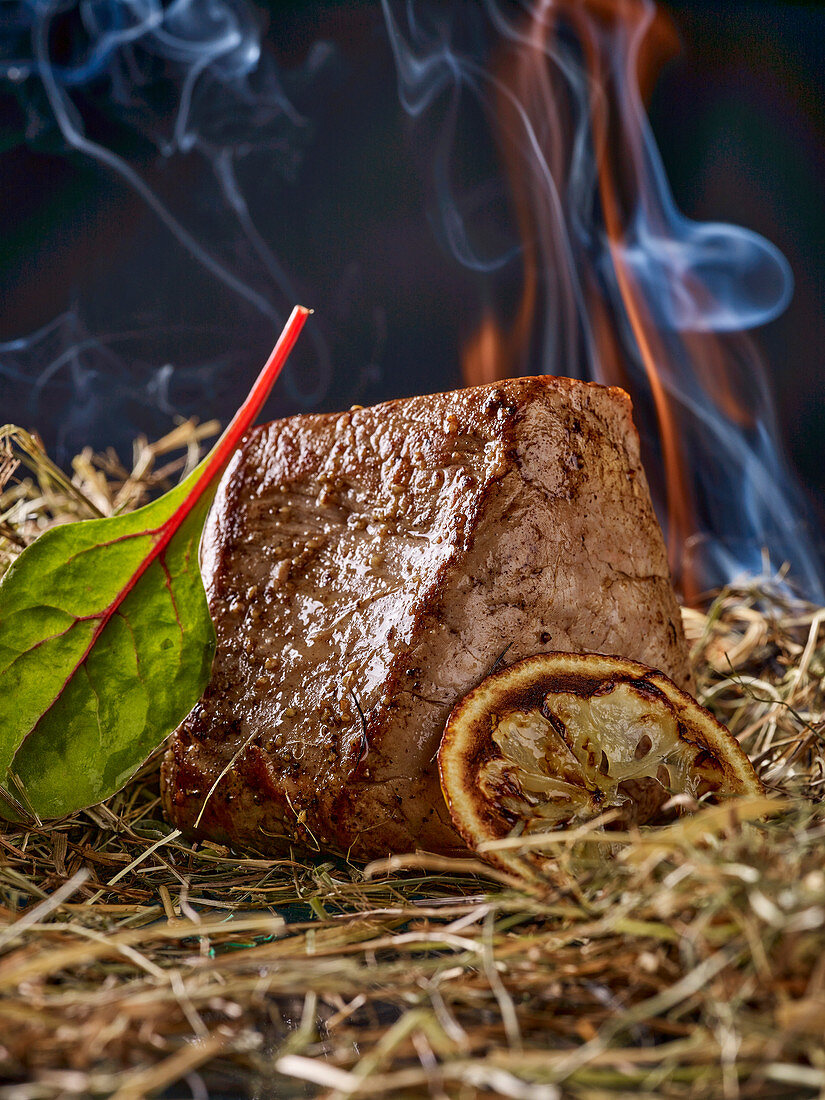 Veal steak on a bed of straw