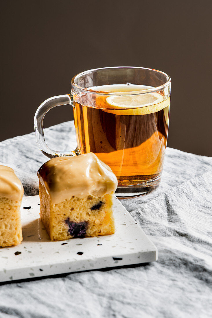 Caramelized chocolate and blueberry mini pound cakes and cup of black tea.