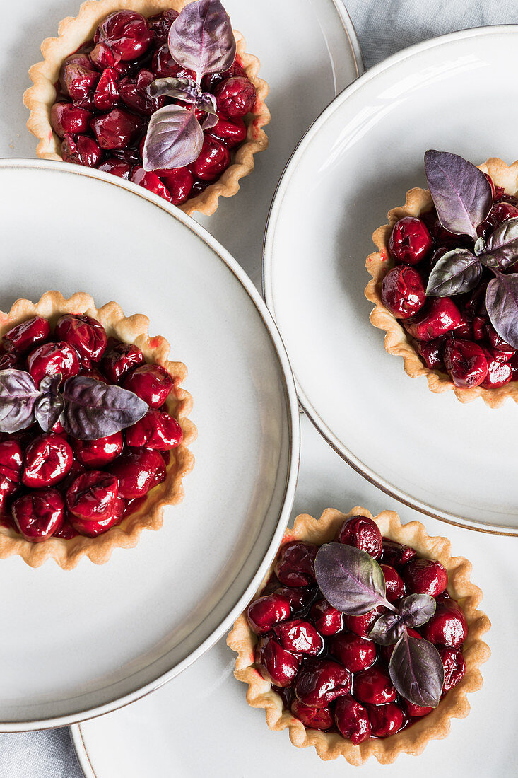 Cherry tartlets with red basil