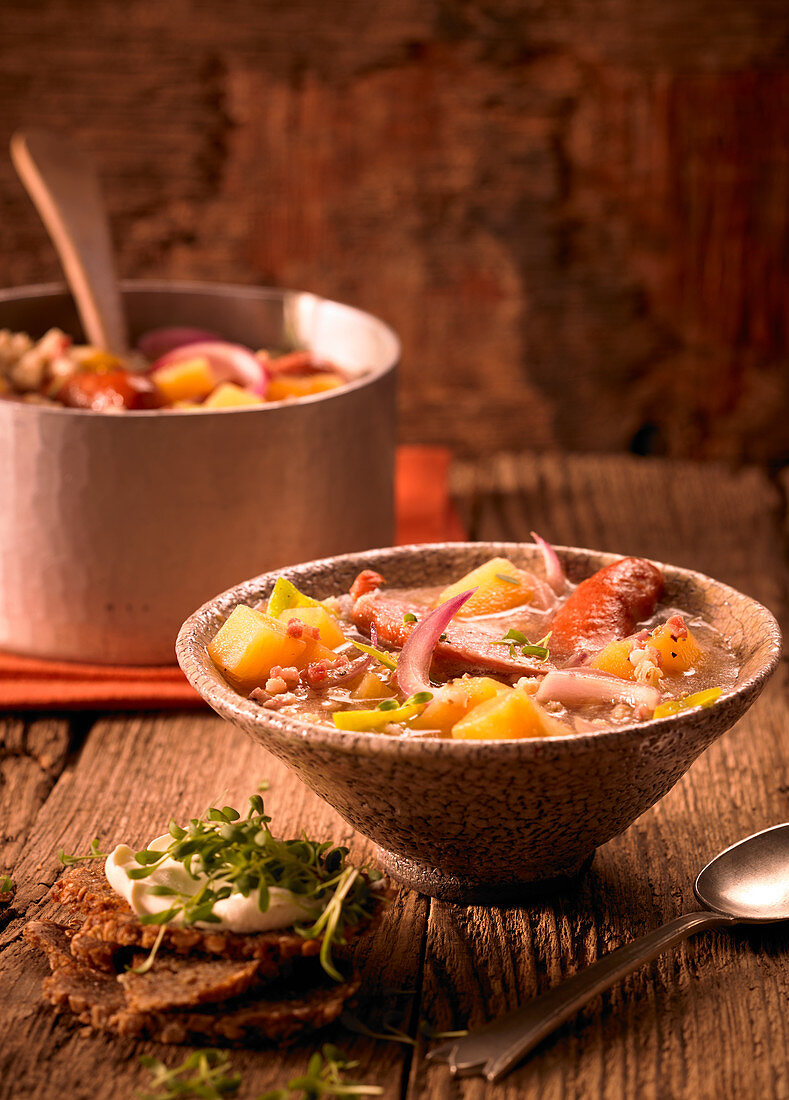 Barley stew with turnips and Mettenden (smoked pork sausages)