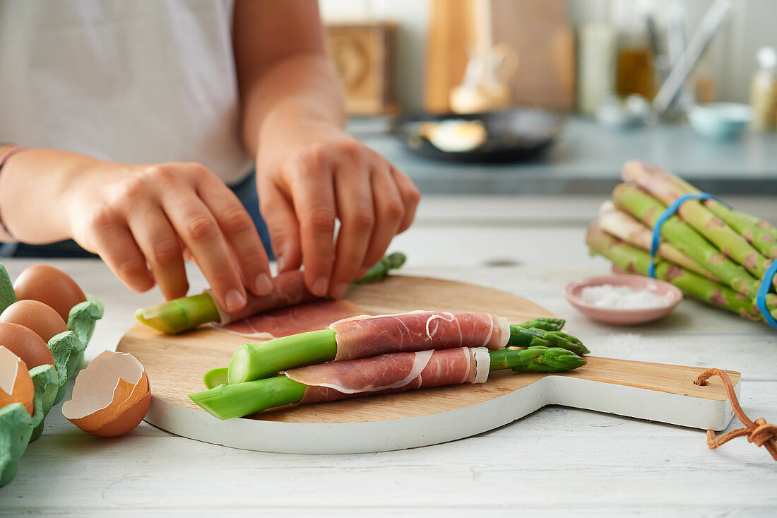 Asparagus and ham rolls being made