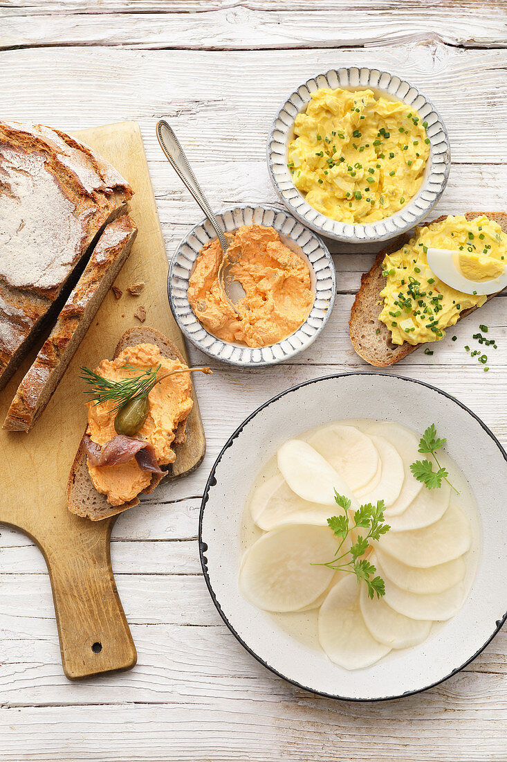 A Heurige buffet with Liptau cheese, an egg salad spread and pickled radishes