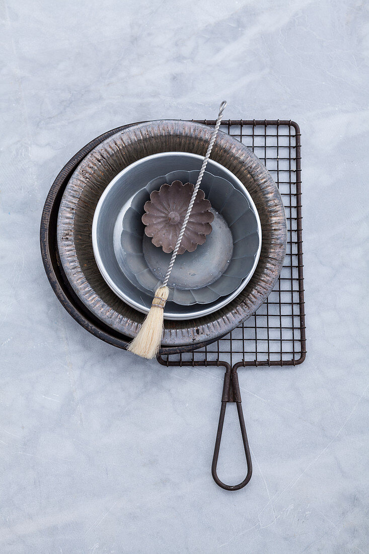 Baking tins, a cooling rack and a pastry brush