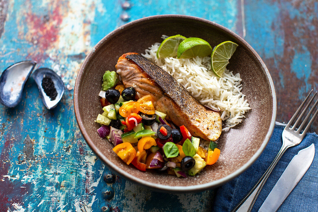 Fried salmon with avocado salsa and rice