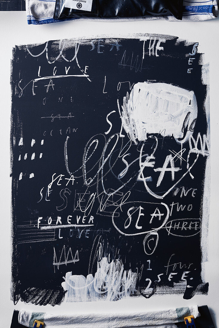 Lettering and drawings on chalkboard background