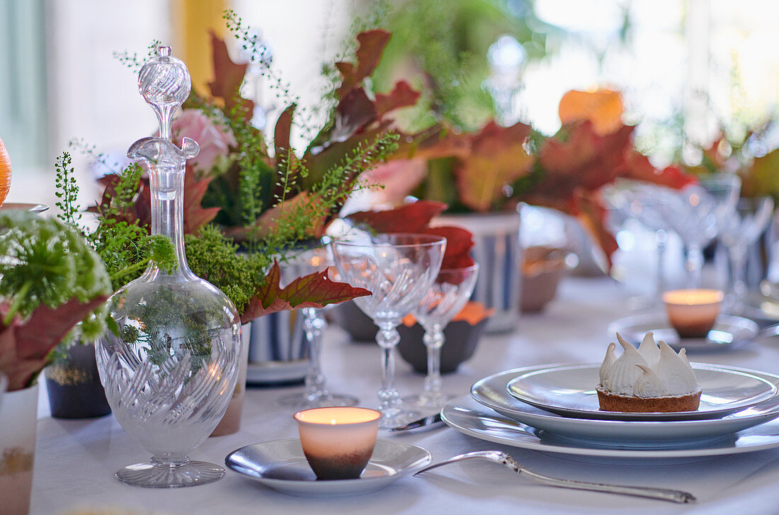 A festively laid table with tea lights and meringues