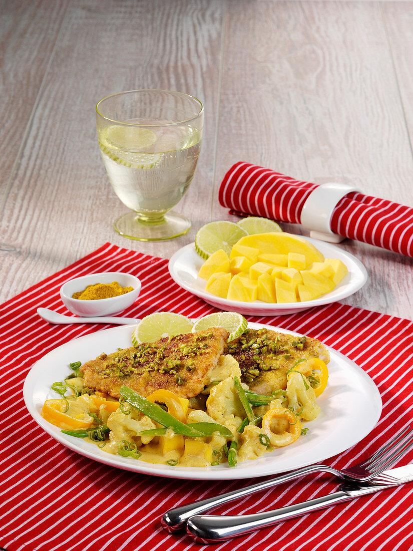 Pistachio turkey escalope with a cauliflower and pepper medley