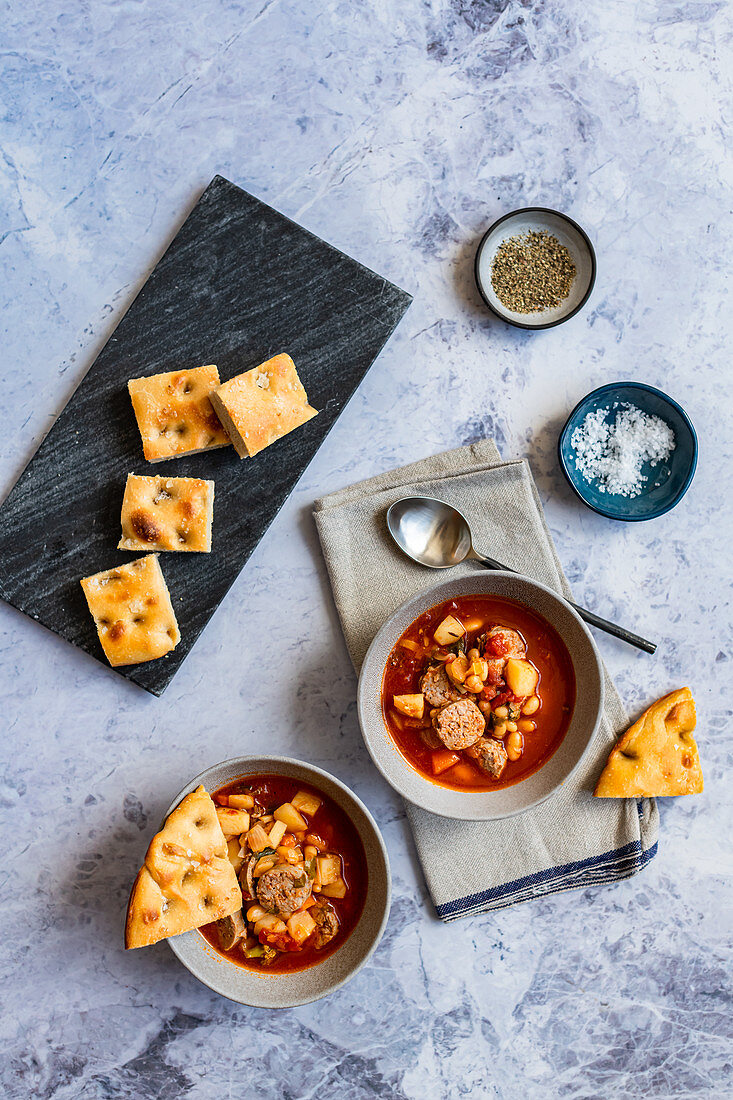 Homemade minestrone soup with Italian sausage and focaccia