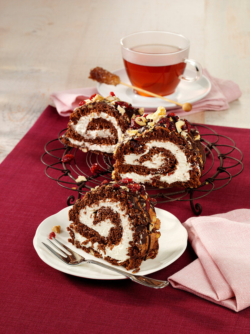 Chocolate brownie Swiss roll with walnuts and cranberries