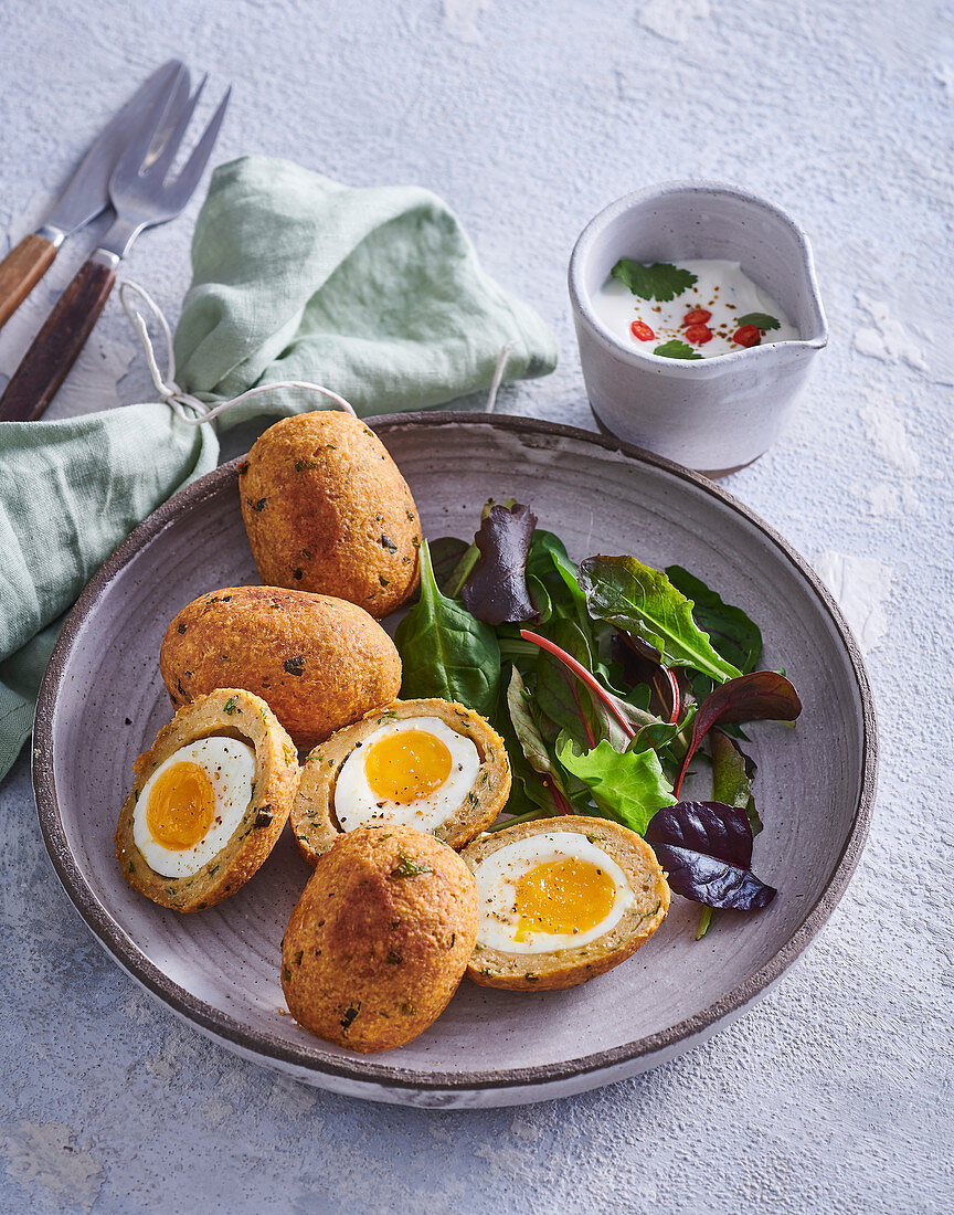 Scotch eggs with salad