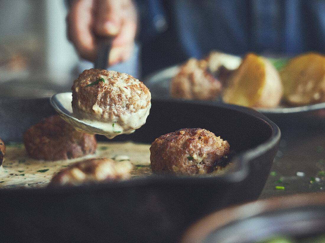 Köttbullar (Swedish meatballs) in a cast iron pan
