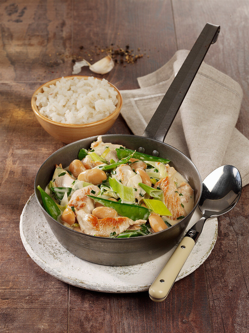 Turkey and leek casserole with giant beans in a herb sauce