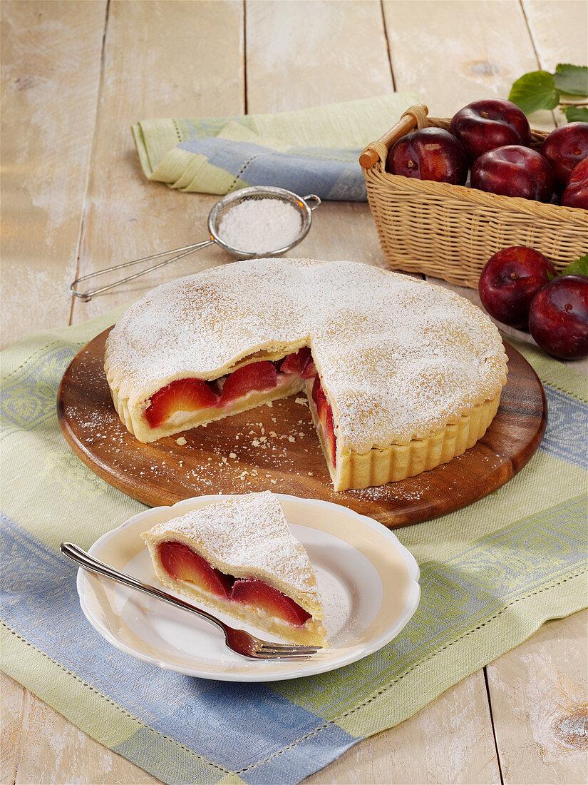 Covered plum pie