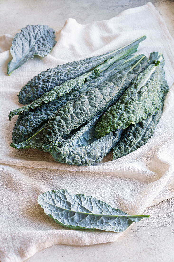 Lacinato kale leaves on table