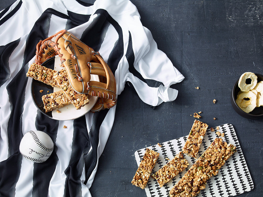Muesli bar with cereal flakes, apple, honey and cocoa nibs