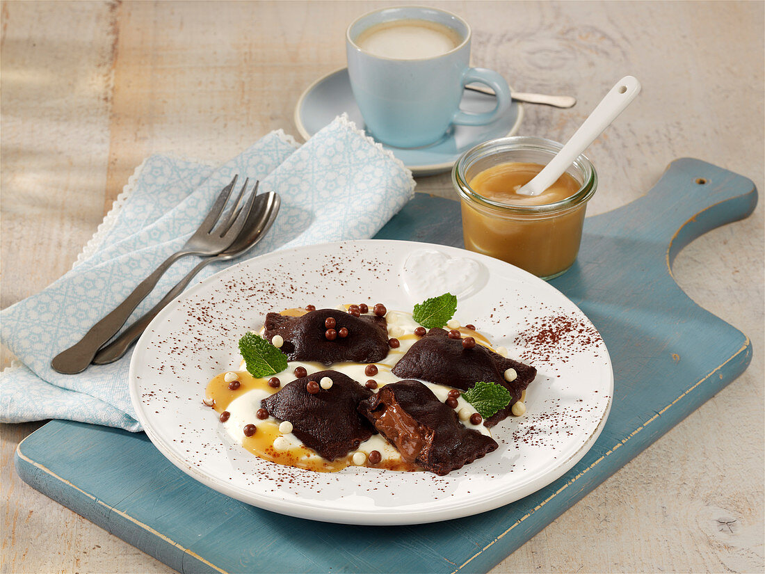 Chocolate ravioli with mascarpone filling and caramel sauce