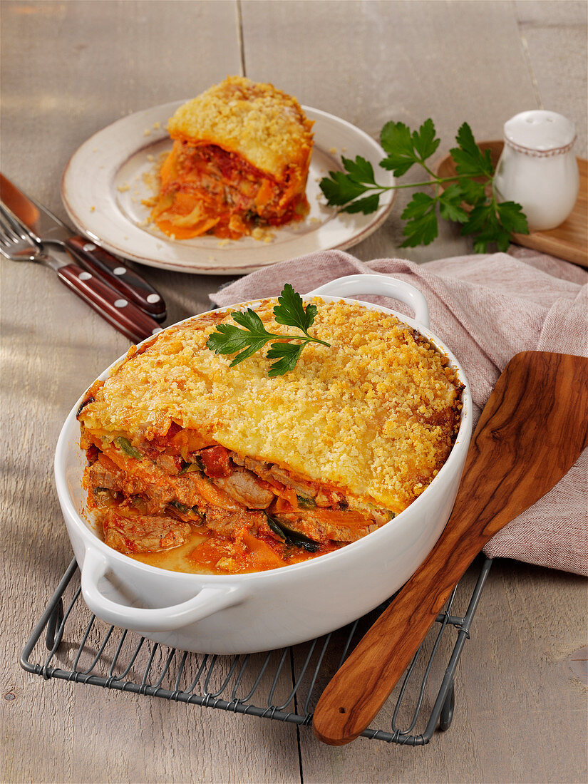 Casserole with pork fillet, tomatoes, sweet potatoes and sour cream