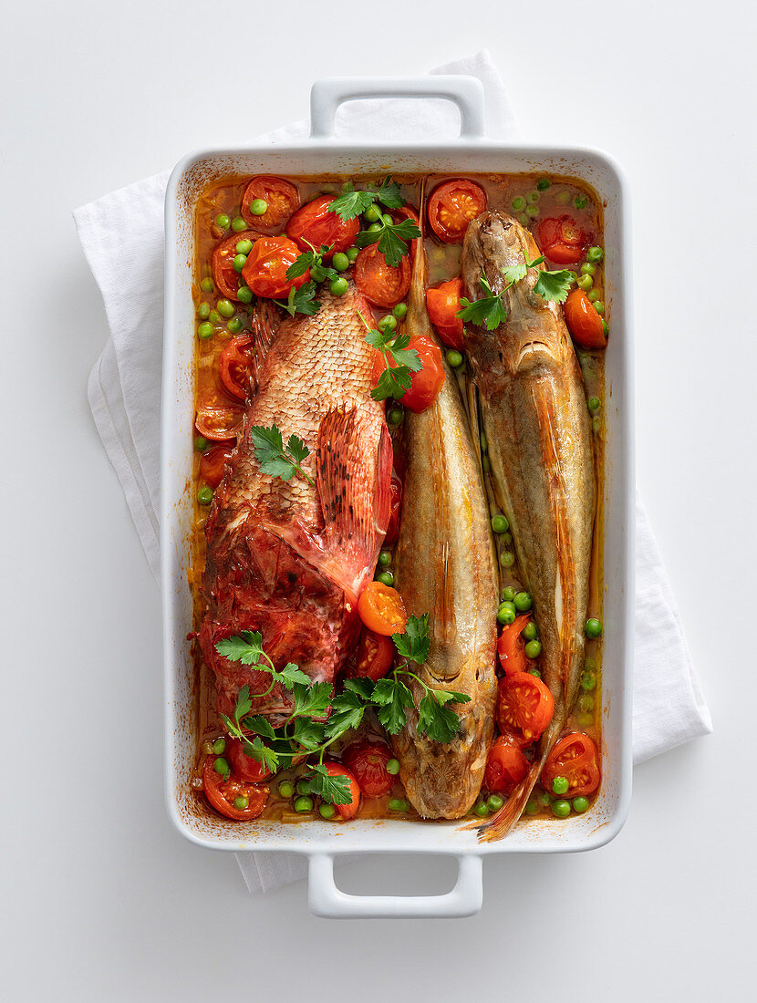Red gurnard and scorpion fish in a saffron sauce with peas