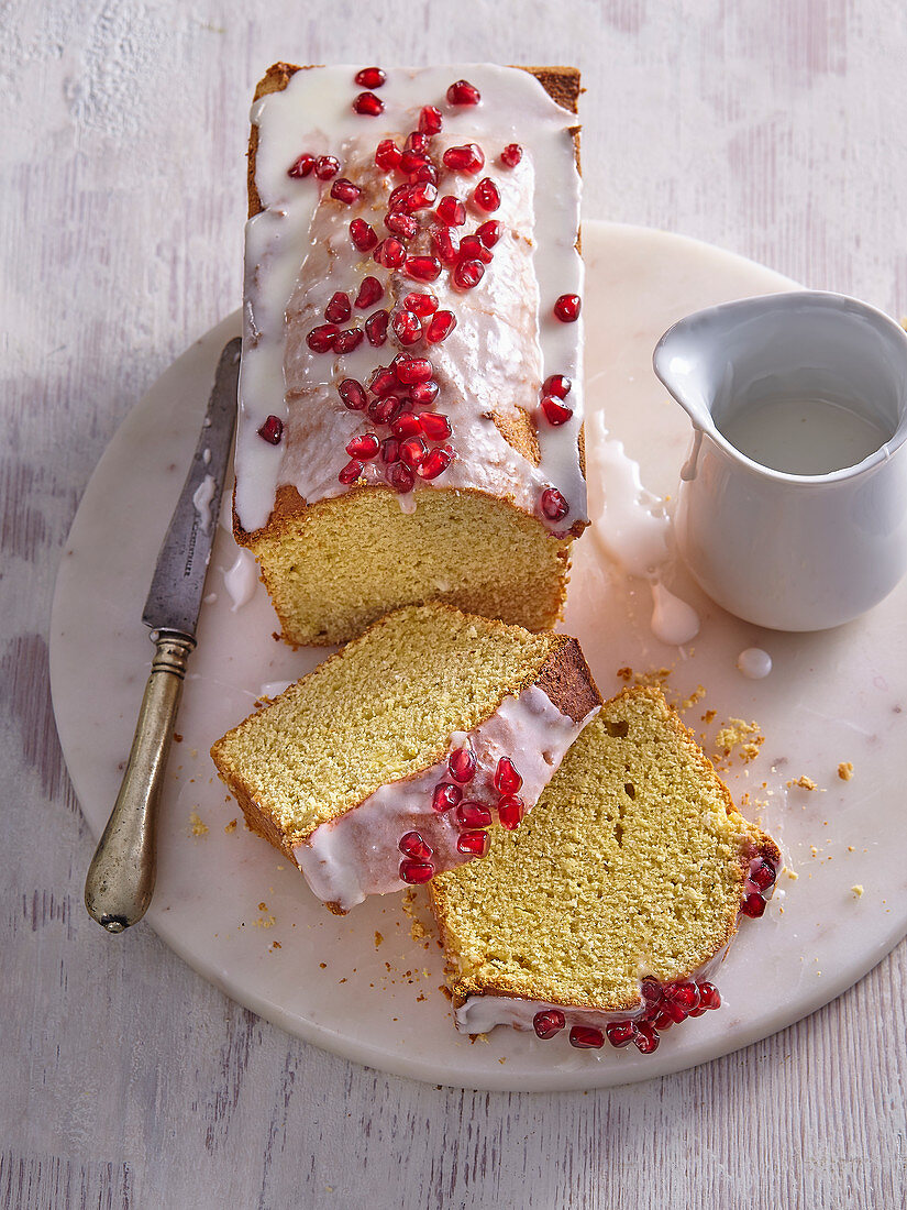 Coconut box cake with sugar icing and pomegranate seeds