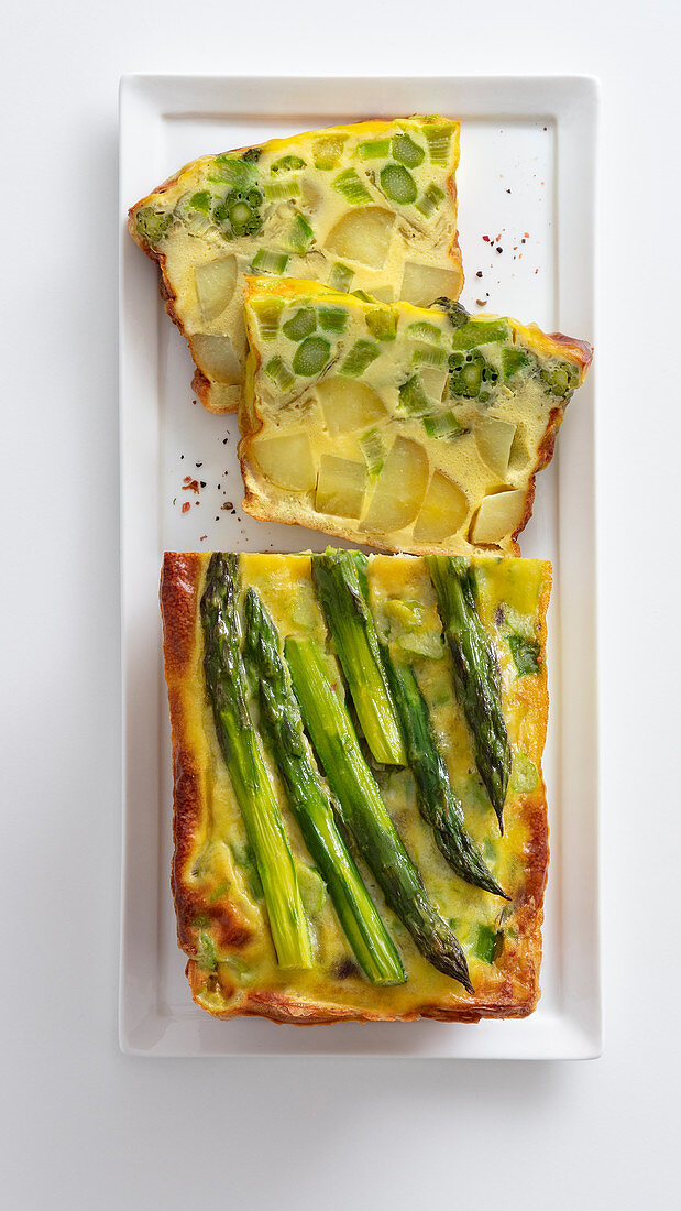 Oven-baked frittata made with new potatoes, asparagus and spring onions