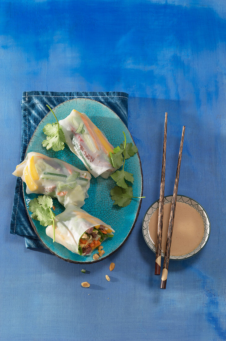 Vietnamese summer rolls with beef fillet, mango and sprouts